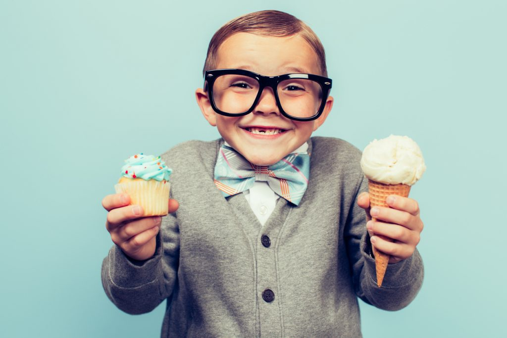 Boy Holds Ice Cream and Cupcakes