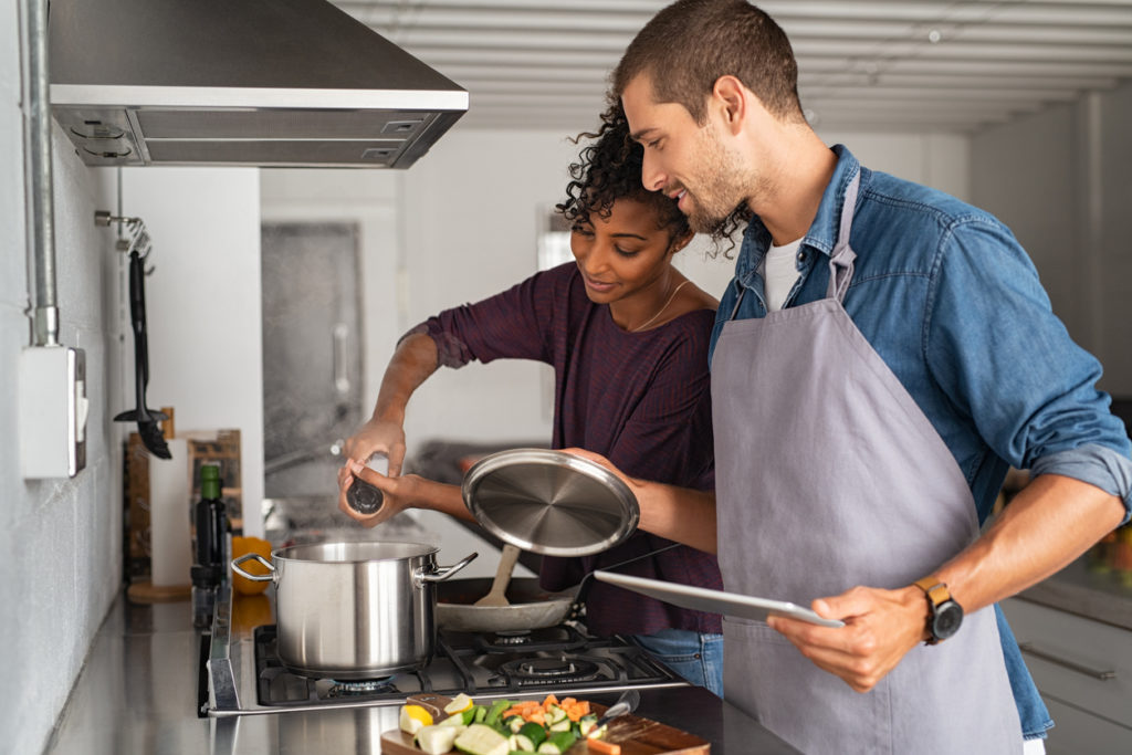 Couple boiling water in the kitchen