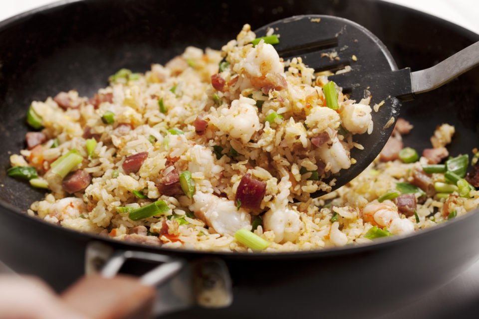 Fried Rice with shrimp and roast pork in a wok.