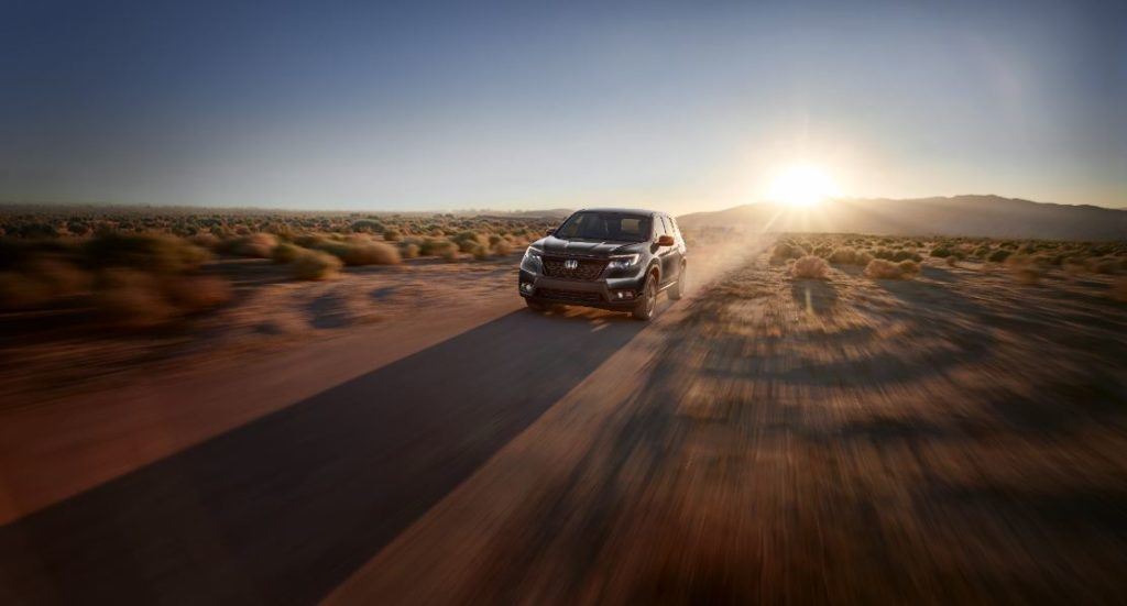 A 2021 Honda Passport driving in the desert.