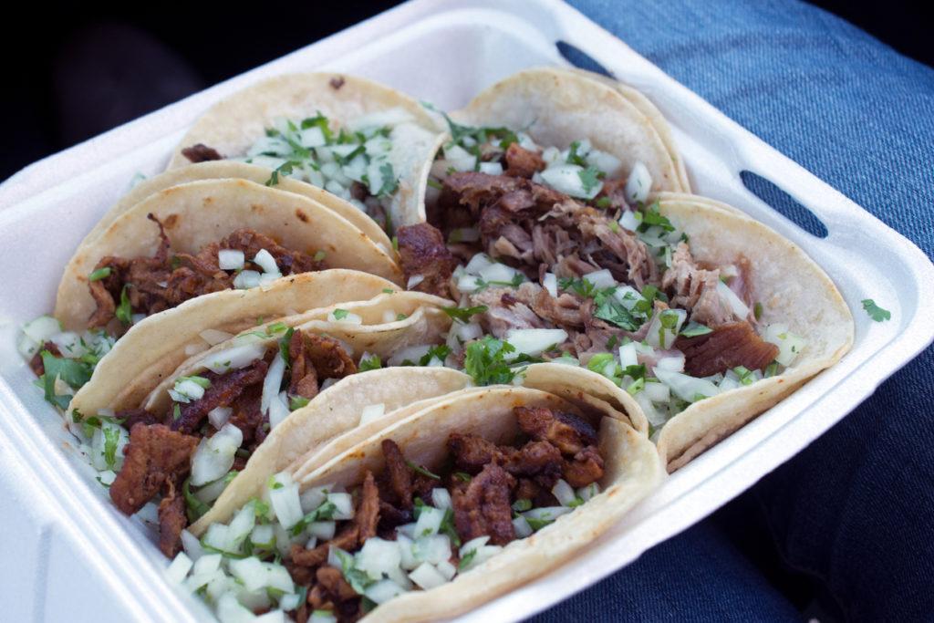 six takeout pork tacos with cilantro